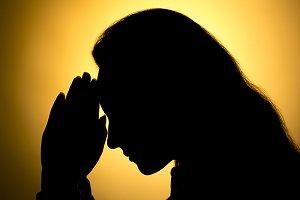 praying hands in black
