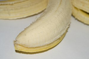 Peeled banana front view