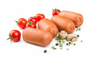 Sausages with tomatoes and mushrooms