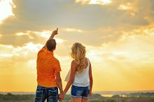 Loving couple looking at sky