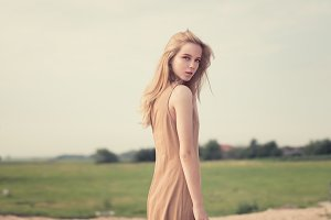 girl in a long, beige dress