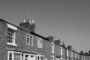 A row of terraced houses in black and white