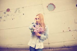 blonde with a bouquet of lilacs