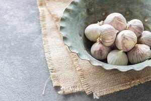 Garlic in vintage copper plate