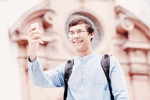 Tourist taking selfie with phone
