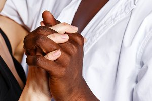 Interracial love. Hand in hand.