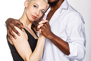 Multiracial couple hug each other