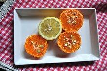 mandarins and lemon on a tray
