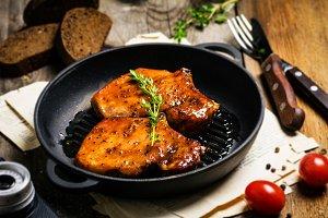Grilled pork chops in skillet