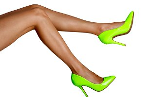 Female legs in green shoes