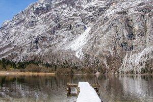 Snow covered pier by Bohinj lake