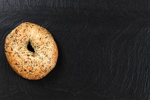 Fresh bagel on natural slate