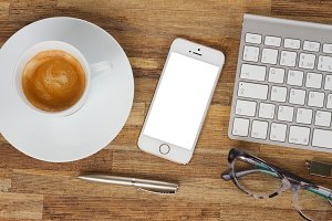 Office table with phone and coffee