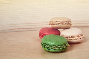Macarons on wooden table