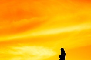 Woman at sunset, silhouette
