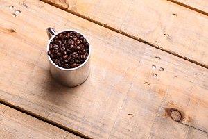 Coffee beans in a mug