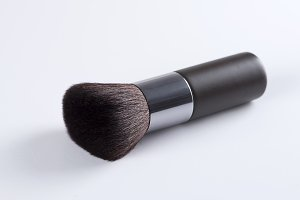 Thick brush for makeup on white background