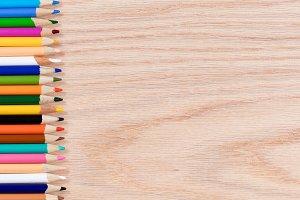 Colorful Pencils on Oak Desktop