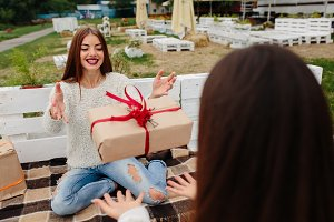 Girls throws gifts to each other