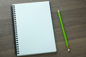 blank spiral notebook and pencil