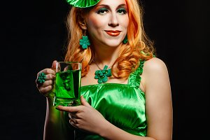 Saint Patrick's Day. Girl mug of ale