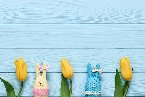 Easter background, rabbits and tulips on wood