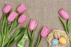 Easter background, eggs, rabbit, purple tulips