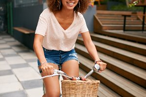 African young girl enjoying bicycle