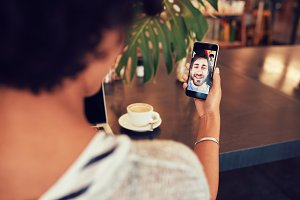 Woman having a videochat with friend