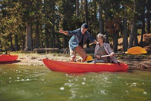 Senior couple on kayak in the lake
