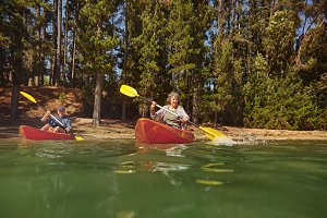 Mature couple canoeing on a lake