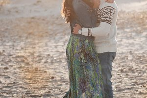 Lovely young couple on the beach
