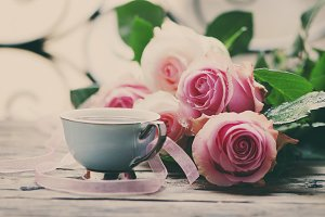Pink roses and coffee