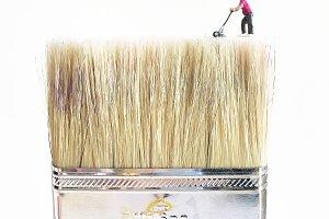 Tiny Man Mowing a Large Paintbrush