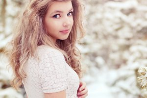 Pretty girl in winter forest