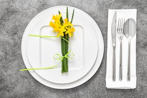 Table place setting with flowers