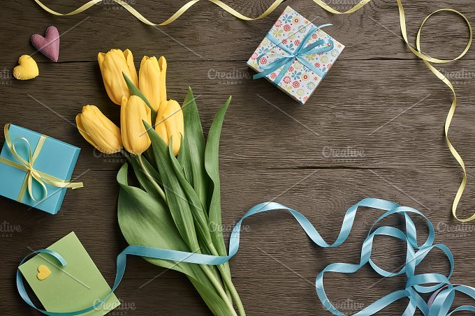 Mothers Day background. Tulips, gift boxes on wood - Holidays
