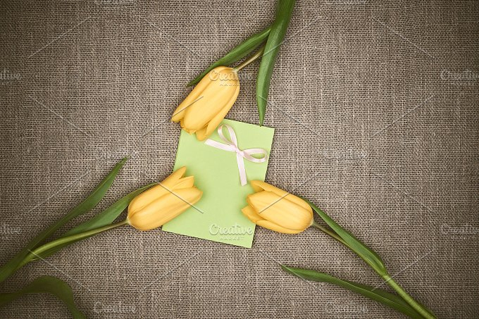 Mothers Day background. Tulips, note on sackcloth - Holidays