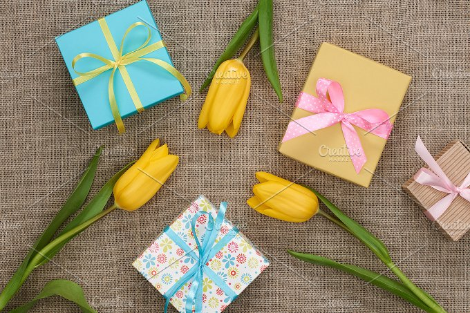 Mothers Day background. Tulips, gifts on sackcloth - Holidays