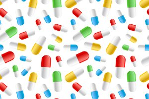 Colourful pills capsules on white