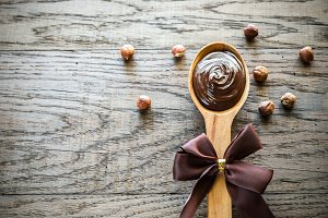 Wooden spoon of chocolate cream