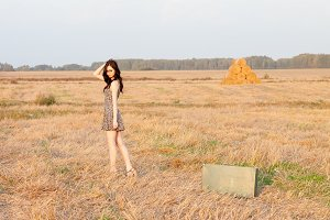 girl in a short dress in the field