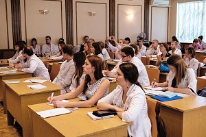 Doctors, students at lecture