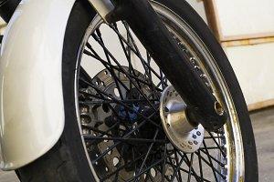 Chrome wheel of white motorcycle