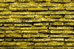 Golden marble stone brick wall