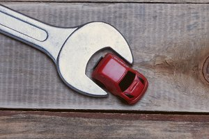 small toy car and wrench closeup