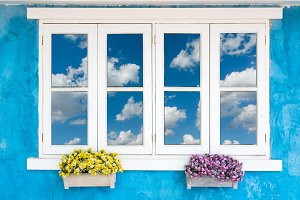 Window with cloud on blue sky