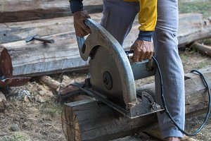 electric circular saw cutting wood