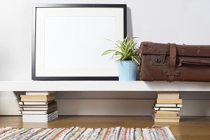Black picture frame with suitcase