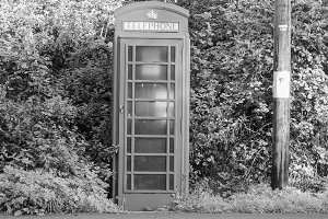 Red phone box in London in black and white